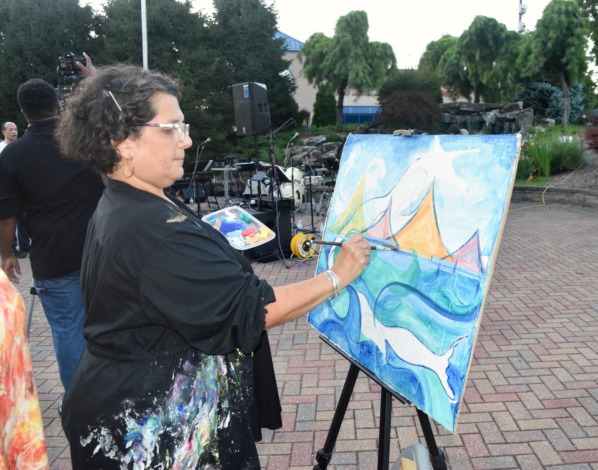 Live painter Patty Eljaiek
